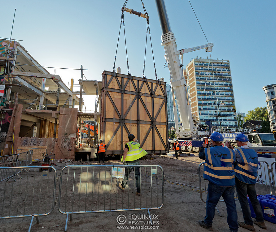 London, United Kingdom - 20 September 2019<br /> EXCLUSIVE SET - Aerial construction specialists and demolition experts use a huge crane to carefully lift intact, a twenty five ton, two-story wall, to preserve a famous Banksy rat image which has been covered up for years. Teams from specialist companies have spent over six weeks cutting around the artwork and fitting custom made eight ton steel supports to enable them to save the historic piece of art. Work has started on the construction of a new twenty seven floor art'otel hotel on the site of the old Foundry building in Shoreditch, east London, and a condition of the planning permission was to preserve the historical Banksy graffiti. A second section of the painting, an image of a TV being thrown through a broken window has already been cut out and moved separately. After the hotel construction is complete the two parts of the Banksy painting will be displayed on the hotel. Our pictures show the stages of work to protect the image, culminating in the lifting of the three story wall by crane. Video footage also available.<br /> (photo by: EQUINOXFEATURES.COM)<br /> Picture Data:<br /> Photographer: Equinox Features<br /> Copyright: ©2019 Equinox Licensing Ltd. +443700 780000<br /> Contact: Equinox Features<br /> Date Taken: 20190920<br /> Time Taken: 17093369<br /> www.newspics.com