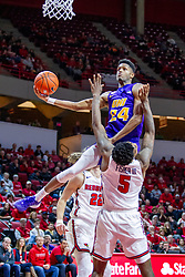NORMAL, IL - December 31: Isaiah Brown splits defenders Matt Chastain and Keith Fisher III for a lay up during a college basketball game between the ISU Redbirds and the University of Northern Iowa Panthers on December 31 2019 at Redbird Arena in Normal, IL. (Photo by Alan Look)