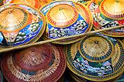 Hats for sale in the Damnern Saduak floating market, Bangkok, Thailand