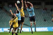 Jack Lam, Adam Ashley-Cooper and Kane Douglas jumps for the ball. Waratahs v Hurricanes. 2012 Super Rugby round 15 match. Allianz Stadium, Sydney Australia on Saturday 2 June 2012. Photo: Clay Cross / photosport.co.nz
