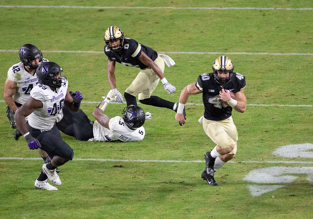 November 14, 2020:  Purdue running back Zander Horvath (40) runs with the ball as Northwestern defensive lineman Adetomiwa Adebawore (49) pursues during NCAA football game action between the Northwestern Wildcats and the Purdue Boilermakers at Ross-Ade Stadium in West Lafayette, Indiana. Northwestern defeated Purdue 27-20.  John Mersits/CSM.