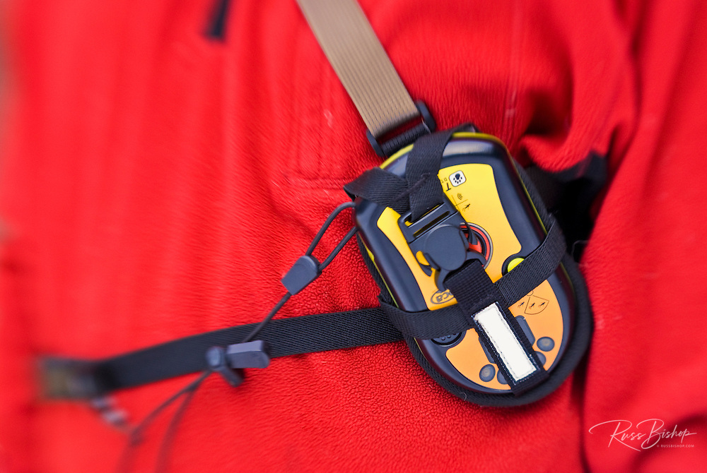 Detail of an avalanche beacon properly worn on a skier's chest, Sequoia National Park, California
