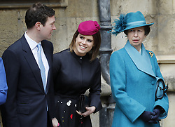 Princess Eugenie stands with her fiance Jack Brooksbank and the Princess Royal, as they wait for Queen Elizabeth II to arrive for the Easter Mattins Service at St George's Chapel, Windsor Castle, Windsor.