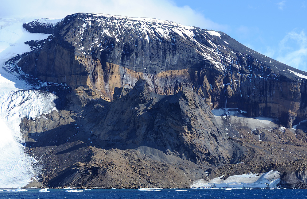 Multi-coloured cliffs of  volcanic rocks on the Antarctic Peninsula near Brown Bluff.  Brown Bluff, Antarctic Peninsula. Antarctica. 01Mar16