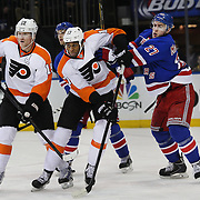 Ryan McDonagh, (right), Rangers, and Wayne Simmonds, Flyers, challenge for position during the New York Rangers Vs Philadelphia Flyers, NHL regular season game at Madison Square Garden, New York, USA. 26th March 2014. Photo Tim Clayton