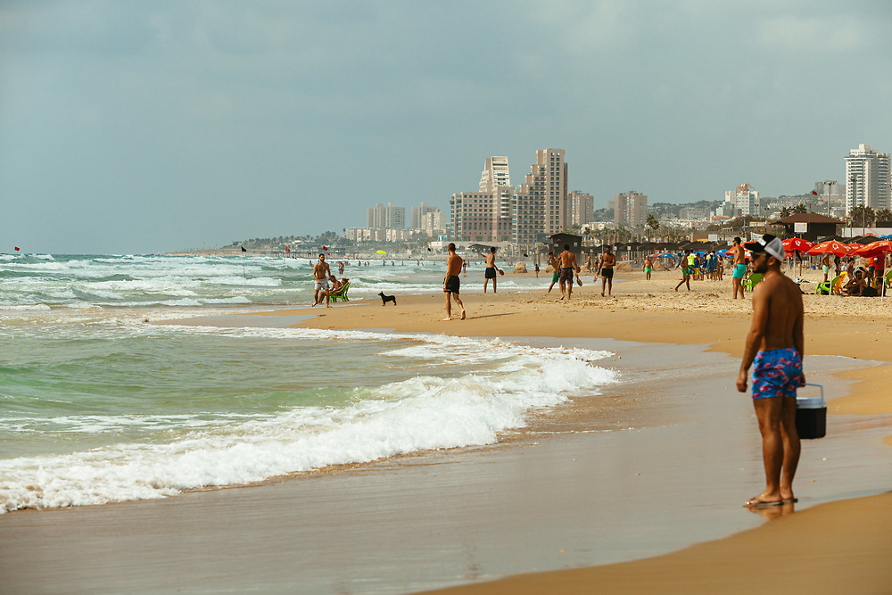 People enjoy a summer afternoon at the Student Beach in Haifa, northern Israel.