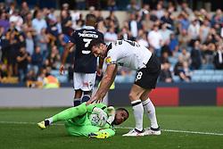 Derby County's David Nugent checks on Millwall goalkeeper Jordan Archer
