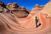 Hiker at The Wave in the Coyote Buttes, Paria Canyon-Vermilion Cliffs Wilderness, Arizona