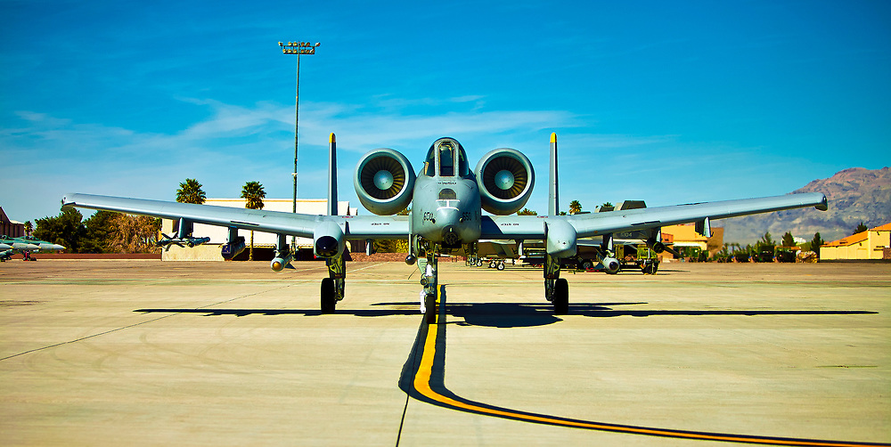 """An A-10 Warthog on the ramp at Nellis Air Force Base, just prior to departure on a """"Red Flag"""" exercise.  <br /> <br /> Created by aviation photographer John Slemp of Aerographs Aviation Photography. Clients include Goodyear Aviation Tires, Phillips 66 Aviation Fuels, Smithsonian Air & Space magazine, and The Lindbergh Foundation.  Specialising in high end commercial aviation photography and the supply of aviation stock photography for advertising, corporate, and editorial use."""