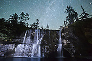 Tsusiat Falls at night, spilling onto the beach along the West Coast Trail, British Columbia, Canada.
