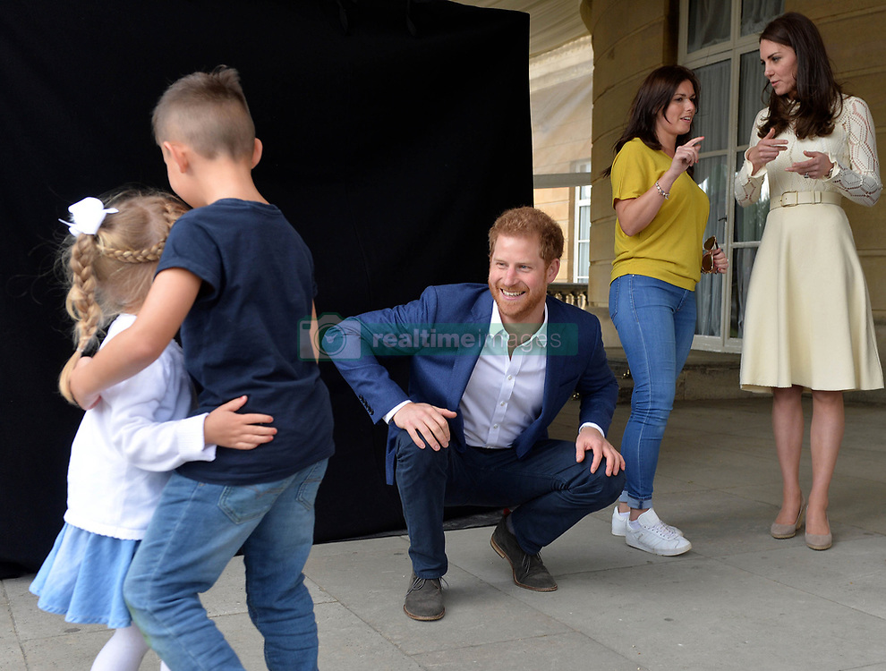 The Duke and Duchess of Cambridge and Prince Harry host Party at The Palace, a special party in the grounds of Buckingham Palace to honour the children of those who have died serving in the Armed Forces, in London, UK, on the 13th May 2017. Picture by Andrew Parsons/WPA-Pool. 13 May 2017 Pictured: Prince Harry, Catherine, Duchess of Cambridge, Kate Middleton. Photo credit: MEGA TheMegaAgency.com +1 888 505 6342