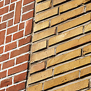 adjoined wall of yellow brick and red brick