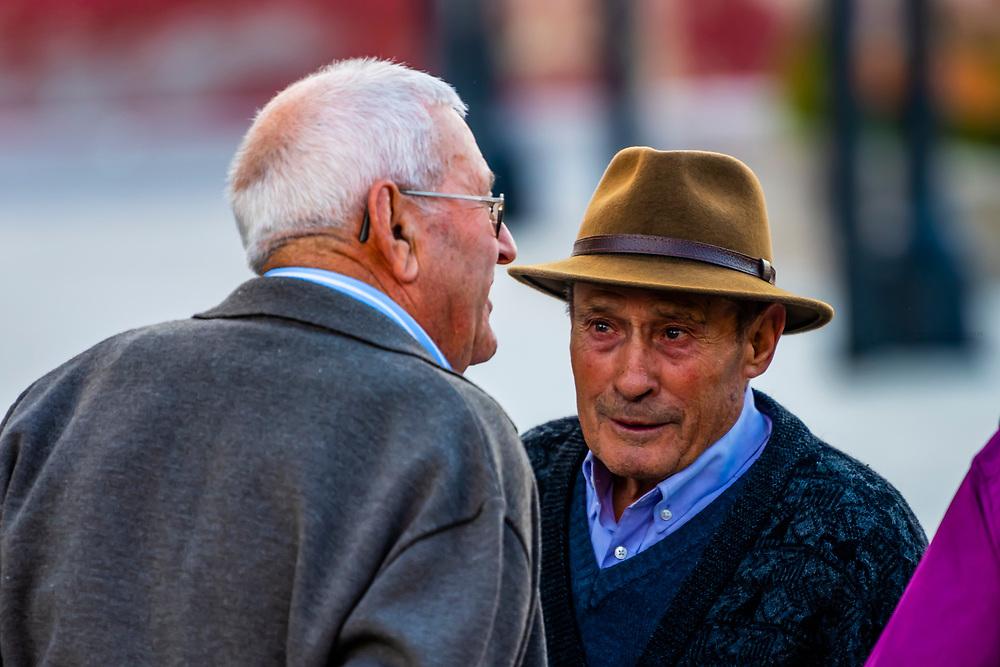 Elderly men talking in the town square, Alhama de Granada,Granada Province, Andalusia, Spain.