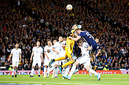Guilherme Marinato of Russia (1) (Locomotiv Moscow)takes the ball off the head of Scotland forward Oliver McBurnie (9) (Sheffield United) during the UEFA European 2020 Qualifier match between Scotland and Russia at Hampden Park, Glasgow, United Kingdom on 6 September 2019.