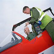 Members of the 'Red Arrows', Britain's Royal Air Force aerobatic team, prepare for next flight in Cyprus.
