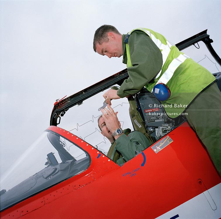 Members of the 'Red Arrows', Britain's Royal Air Force aerobatic team, prepare for next flight in Cyprus.