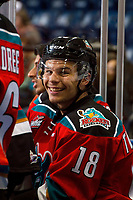 KELOWNA, CANADA - NOVEMBER 29: Carsen Twarynski #18 of the Kelowna Rockets smiles on the bench after scoring his third goal and earning a hat trick against the Prince George Cougars on November 29, 2017 at Prospera Place in Kelowna, British Columbia, Canada.  (Photo by Marissa Baecker/Shoot the Breeze)  *** Local Caption ***