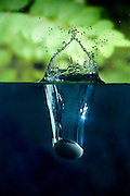 A rock splashing into water. Photographed with a high-speed camera.