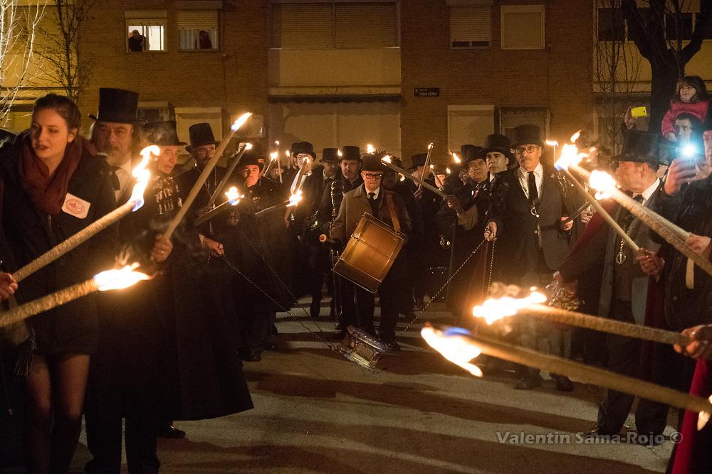 Madrid, Spain. 14th February, 2018. Members of the brotherhood 'La alegre cofradia del entierro de la sardina' carrying the coffin of the sardine during the night parade of the Burial of the Sardine. © Valentin Sama-Rojo