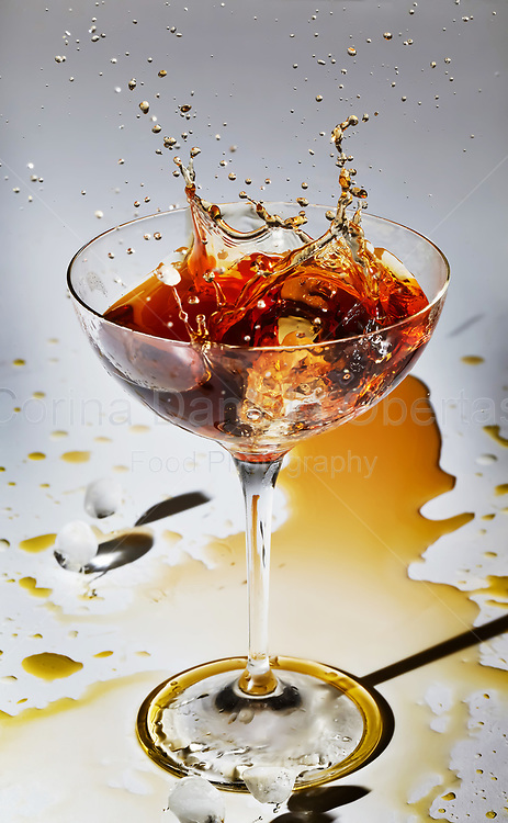 Ice splash inside glass with cocktail. This file is only available at Stockfood.com and can be purchased at this address: https://goo.gl/BM5qD7 Sold exclusively through Stockfood.com