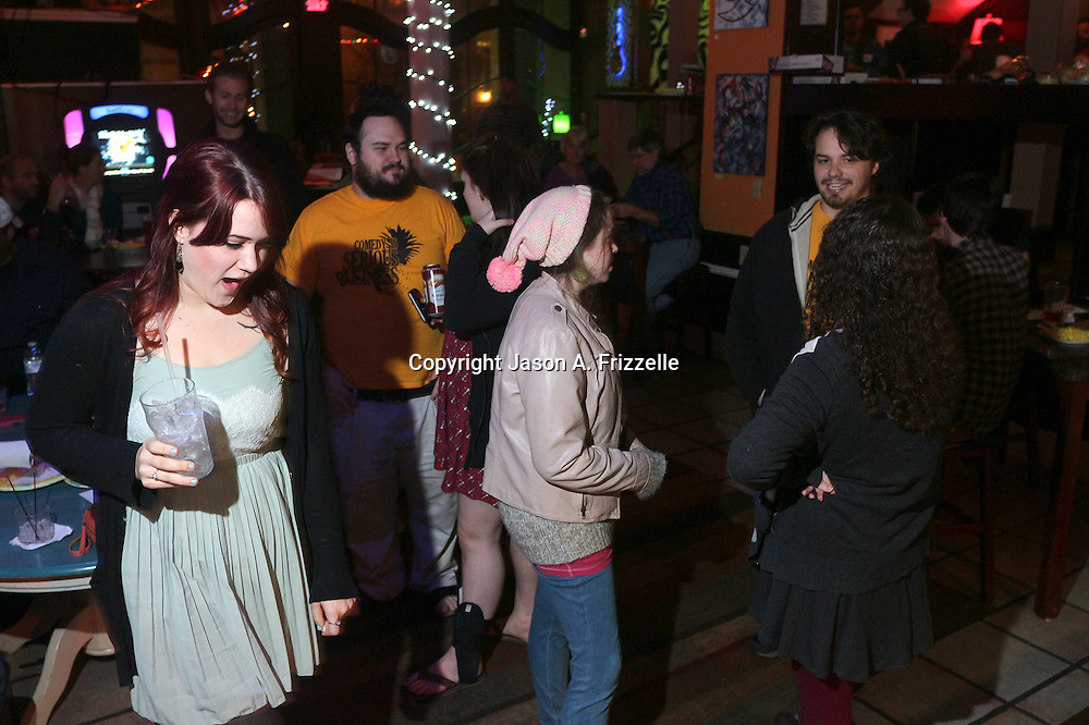 People mingle during Pineapple Shaped Lamps' premiere party for Sketch 22, a show that airs on the Cape Fear CW. (Jason A. Frizzelle)