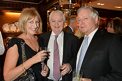 Left to right, NICOLA GOOCH, LORD LAMONT  and SIR NICHOLAS LLOYD at a party to celebrate the publication of 'A Designer's Life' by Nicky Haslam held at Ralph Lauren, 1 New Bond Street, London on 19th November 2014.