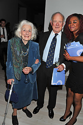 JUNE PARKER and SIR MICHAEL CRAIG-COOPER at a fundraising party hosted by the Kensington and Chelsea Foundation at The Saatchi Gallery, Kings Road, London on 27th September 2011.