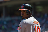 Adam Jones #10 of the Baltimore Orioles waits on-deck during a game against the Minnesota Twins on May 12, 2013 at Target Field in Minneapolis, Minnesota.  The Orioles defeated the Twins 6 to 0.  Photo: Ben Krause