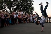 Russian students watch a break dancer outside Moscow university, 2007