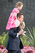 © Licensed to London News Pictures. 08/07/2014. Westminster, UK British Prime Minister David Cameron on Downing Street today 8th July 2014 taking his daughter to Nursery. Photo credit : Stephen Simpson/LNP