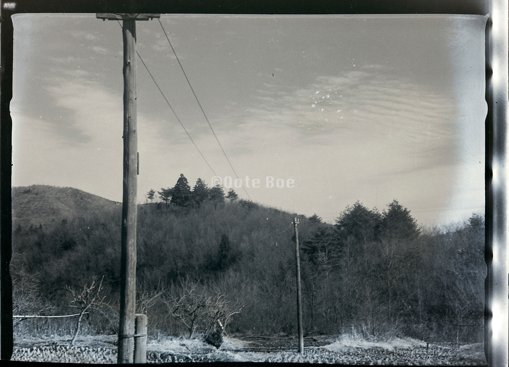 rural landscape with electric cables and wooden poles Japan ca 1940s