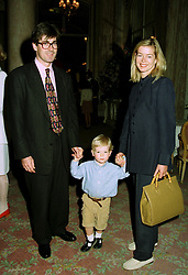MR TIM and LADY HELEN TAYLOR and their son COLUMBUS, at a party in London on 4th July 1997.LZY 24