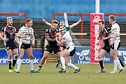 Keighley Cougars loose forward Mike Emmett (13) stops York City Knights hooker Will Jubb (20)  during the Betfred League 1 match between York City Knights and Keighley Cougars at Bootham Crescent, York, England on 25 March 2018. Picture by Simon Davies.
