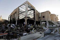 SANAA, Oct. 8, 2016 (Xinhua) -- People inspect a funeral hall after it was targeted by airstrikes in Sanaa, Yemen, on Oct. 8, 2016. The Saudi-led coalition airstrikes on a funeral hall in Yemen's capital Sanaa on Saturday have killed 82 and injured 534, acting health minister Ghazi Ismail told reporters in a press conference on Saturday night. (Xinhua/Mohammed Mohammed) (Credit Image: © Mohammed Mohammed/Xinhua via ZUMA Wire)