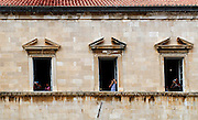 Tourists taking photographs from the City Hall, Dubrovnik old town, Croatia