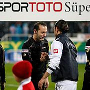 Referee's Cuneyt Cakir (L) during their Turkish superleague soccer match Besiktas between Kasimpasa at the BJK Inonu Stadium in Istanbul Turkey on Saturday, 16 March 2013. Photo by Aykut AKICI/TURKPIX