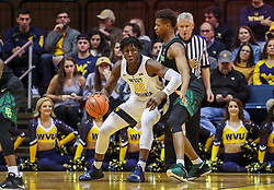 Jan 21, 2019; Morgantown, WV, USA; West Virginia Mountaineers forward Andrew Gordon (12) attempts to make a move during the first half against the Baylor Bears at WVU Coliseum. Mandatory Credit: Ben Queen-USA TODAY Sports