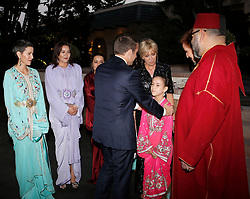 In this photo dated Wednesday, June 14, 2017, French President Emmanuel Macron, center right, and his wife Brigitte Macron, 3rd right, are welcomed by the daughter of King Mohammed VI, Princess Lalla Khadija, as Morocco's King Mohammed VI, right, and his wife Princess Lalla Salma, 2nd right, look on, before attending an Iftar meal, the evening meal when Muslims end their daily Ramadan fast at sunset, at the King Palace in Rabat, Morocco. The visit is the first by the recently elected French president to a North African country and aims to strengthen the relationship between France and Morocco, including cooperation on security issues. Photo by Abdeljalil Bounhar/Pool/ABACAPRESS.COM