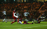 Photo: Andrew Unwin.<br /> Middlesbrough v Fulham. The Barclays Premiership.<br /> 20/11/2005.<br /> Middlesbrough's Jimmy Floyd Hasselbaink (L) fires home his team's second goal.