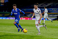 Leeds United midfielder Jack Harrison (22), on loan from Manchester City, and Brighton and Hove Albion striker Alexis Mac Allister (10) in action during the Premier League match between Leeds United and Brighton and Hove Albion at Elland Road, Leeds, England on 16 January 2021.
