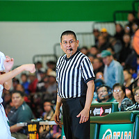 013113  Adron Gardner<br /> <br /> Referee Benson Platero surveys the court during a game between the Laguna Acoma Hawks and the Wingate Bears at Fort Wingate High School Thursday.