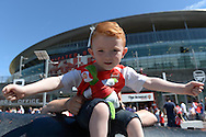 A young Arsenal fan chanting outside Emirates Stadium before k/o. Barclays Premier League, Arsenal v West Ham Utd at the Emirates Stadium in London on Sunday 9th August 2015.<br /> pic by John Patrick Fletcher, Andrew Orchard sports photography.
