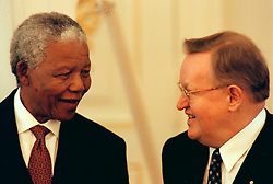 NELSON ROLIHLAHLA MANDELA (July 18, 1918 - December 5, 2013) world renowned civil rights activist and world leader dies at 95. Mandela emerged from prison to become the first black President of South Africa in 1994. As a symbol of peacemaking, he won the 1993 Nobel Peace Prize. Joined his countries anti-apartheid movement in his 20s and then the ANC (African National Congress) in 1942. For next 20 years, he directed a campaign of peaceful, non-violent defiance against the South African government and its racist policies and for his efforts was incarcerated for 27 years. PICTURED: Mar 14, 1999 - Sweden - South African President NELSON MANDELA talks to MARTTI AHTISAARI, President of Finland. (Credit Image: © Aftonbladet/IBL/ZUMAPRESS.com)
