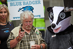 © Licensed to London News Pictures.  01/06/2013. LONDON, UK. Bill Oddie (pictured centre) joins protesters, some dressed as badgers or other animals, on a march to the DEFRA offices on Millbank to try to stop the cull of badgers due to start today (Sat 1 June. Photo credit: Cliff Hide/LNP
