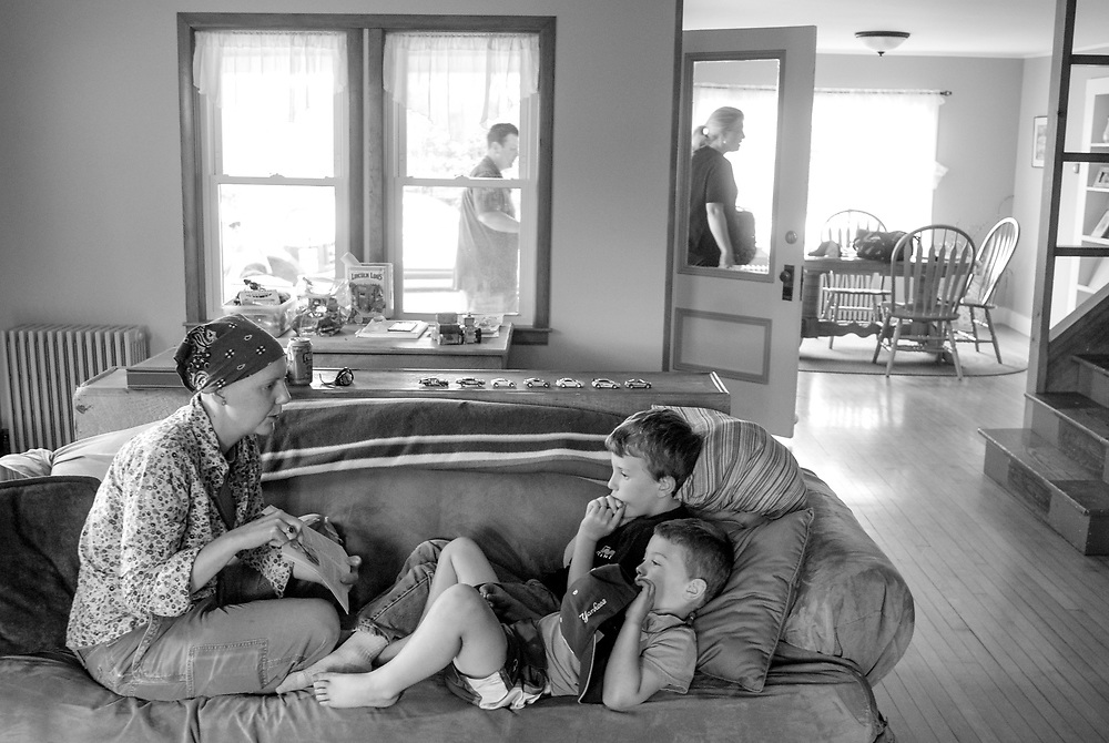 Amelia reads Danny the Champion of the World to Matt and John Lincoln before dinner Tuesday, May 22, 2012. About a month after relapse.