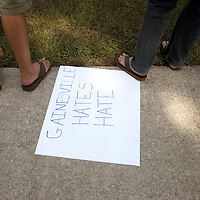 GAINESVILLE, FL -- Sept. 10, 2010 -- Students protest Florida pastor Terry Jones, whose plans are on hold to burn the Koran on Sept. 11th, outside of the Dove World Outreach Center in Gainesville, Fla., on Friday, September 10, 2010.  (Chip Litherland for The New York Times)
