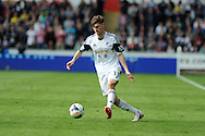 Ben Davies of Swansea city in action. Barclays Premier league match, Swansea city v Southampton at the Liberty stadium in Swansea, South Wales on Saturday 3rd May 2014.<br /> pic by Andrew Orchard, Andrew Orchard sports photography.