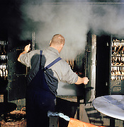 A man cooking fish in Binz, on the island of Rugen, northern Germany