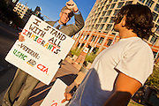 17 OCTOBER 2011 - PHOENIX, AZ:   Occupy Phoenix protesters in front of city hall in Phoenix, AZ, Monday morning. About 40 people spent Sunday night on the sidewalks around the Cesar Chavez Plaza in Phoenix, AZ, the defacto headquarters of the Occupy Phoenix protest. Early Monday morning they got up to continue their chants and protests against Wall Street, the growing income gap between rich and poor in the US, and money in politics. Monday marks the third day of Occupy Phoenix.   PHOTO BY JACK KURTZ