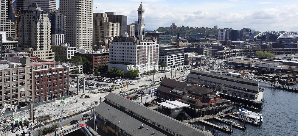 The progress on taking down the Viaduct is seen from atop the Seattle Great Wheel, looking south of University Street, with the Smith Tower in the background at center, Sunday May 19, 2019. (Ken Lambert / The Seattle Times)